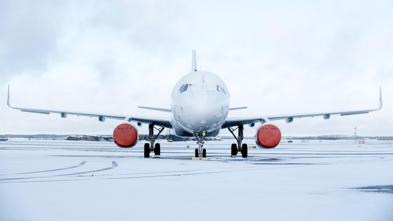 A Finnair aircraft with engine covers