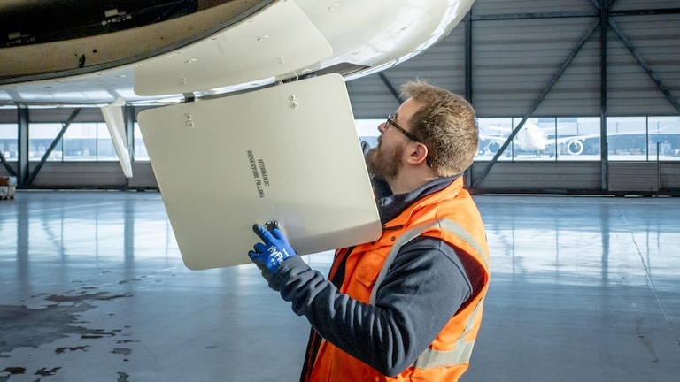 Finnair engineer inspects plane to be recycled